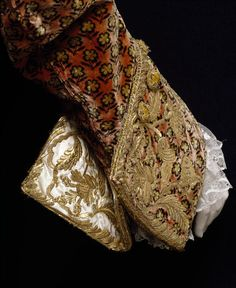 Sleeve and cuff detail of a Court suit,  France (woven), Italy (made), 1765-1770 (made), Silk velvet, embroidered with silver-gilt thread, purl and sequins, lined with silk satin, backed with corded silk, hand-sewn. V Search the Collections