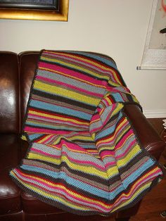 Stripes! Blanket, free pattern (no. 70805AD) by Lion Brand Yarn. Super-easy rows of alternating DC & SC, great for a beginner & a good stash-buster.  This is a lighter-weight  blanket for warmer months.  Pic from Ravelry Project Gallery.   . . . .   ღTrish W ~ http://www.pinterest.com/trishw/  . . . .   #crochet #afghan #throw