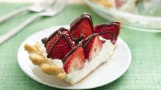 Inspired by recipes for cheesecake and cream pies, this heavenly whipped cream-cream cheese filling nestles beneath fresh strawberries and drizzled chocolate.  If you wish, substitute raspberries or blueberries, or a combination.