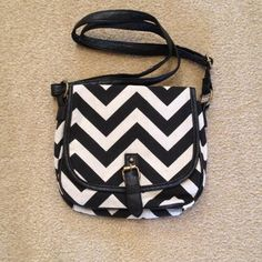Chevron Black/beige cross body/shoulder bag Faux leather black Strap can be adjusted for crossbody or shoulder carry. Flap and snap front closure. Zip slot on one side and 2 open tech slots on other side of black interior. NWOT. Bags Shoulder Bags