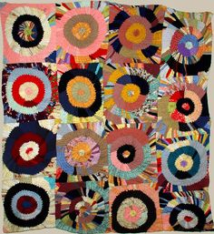 TARGETS' VINTAGE PIECED QUILT- circles of folded layered triangles resembling a Sonia Delauney.