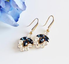 Navy Blue Earrings, Gold Leaf Earrings, Navy #fallweddingjewelry #bridalleafearrings #navyblueearrings #bluebridalearrings #somethingblue #crystalleafearring #blueweddingearring #bridesmaidearrings #bluebridesmaids #goldleafearrings #weddinggifts #leafbridalearrings #blueearrings