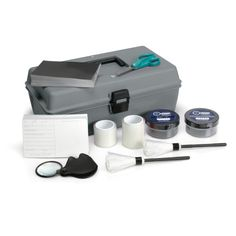 This kit contains everything you need for latent print dusting — two colors of fingerprint powder (Silver/Gray and Black), two colors of backing cards and two Zephyr® brushes. The Zephyr brushes are stored in protective tubes and held by clips inside the lid. The lift tape and powders are held in a fitted insert. A pair of scissors and a magnifying glass are also included. 1 – Kit Box C contains: Silver/Gray Powder, 44g (2oz.)