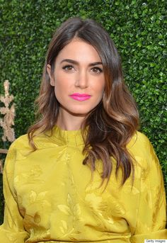 Nikki Reed channeled spring in this chartreuse dress and creamy pink lip color. Reed's ombré waves and bronzed skin also draw our attention to her beautiful brown eyes.
