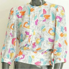 Vintage Blouse This vintage blouse with its lightweight material is both fun and feminine. Pairs well with jeans or skirt. Excellent condition. True to size. Laura and Jayne  Tops Blouses