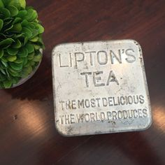 This stunning shiny Lipton Tea tin is so unique. It has lettering on both the lid and the bottom and is perfectly vintage ( not too beat up and