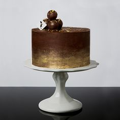 The Millionaire - our rich chocolate cake layered with creamy chocolate ganache, adorned with dark chocolate truffles and brushed with edible gold #specialtycollection #petiteandsweet