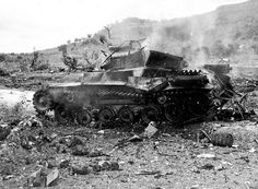 Type 97 Chi-Ha (Type 97 57 mm L/18,4)  From the caption: Japanese 9th Tank Regiment Type 97 Chi Ha medium tank still burning after it had been destroyed by USMC anti-armor teams. The vehicle had taken part in the famed night counter-attack against the 2nd Marine Division's beachhead on June 17-18, 1944. It has the older turret with the 57mm gun.