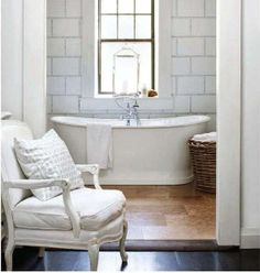 Inspiration from Bathrooms.com: Roll tops are ideal for a small space because they make it feel larger and more luxurious. If the bathroom is tiny, keep the colour scheme simple, too. #bath #bathroom #rolltop
