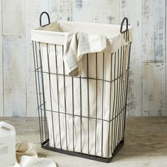 Held up by an industrial-chic wire frame, the lining of the Linen Lined Wire Hamper unties for easy laundry day transporting.