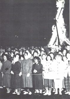 Fans stand at the 1957 Homecoming pep rally while the traditional bonfire burns in the background. From the 1958 Oregana (University of Oregon yearbook). www.CampusAttic.com
