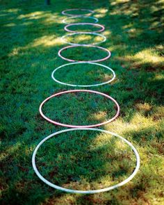 Lay out eight plastic hoops in a straight line. Kids step into each hoop, lift it overhead, and drop it behind as they move forward. (Reset the row before the next person's turn.)