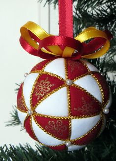 On Sale! Originally $22 now $18  This limited edition Kimekomi Ornament Kit includes everything you need to make your very own Red Snowflakes Kimekomi Ornament. The following materials are included in the kit.  -70mm foam ball (About the size of a tennis ball. Lines already drawn on ball for you.) -red and gold snowflake cotton fabric -white cotton fabric -quilt batting -gold cord -red satin ribbon -yellow satin ribbon -14 pearl headed pins -1 large silver hologram sequin -one set of…