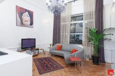 I love the purple curtain,chandelier and the banana plant. From houzz.com