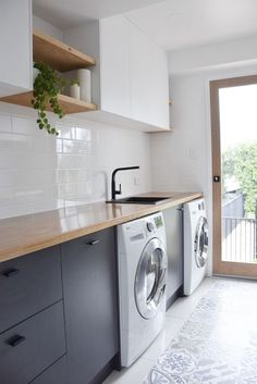 Custom laundry / utility room designed and built by RAW Sunshine Coast. Features solid American White Oak timber bench top and floating shelves. Matte black basin mixer and basin, textured white overhead cabinets and charcoal grey lower cabinets . Laundry Room Cabinets, Laundry In Bathroom, Kitchen Cabinets, Bathroom Grey, Kitchen Wood, Laundry Shelves, Kitchen Tiles, Kitchen White, Dark Cabinets