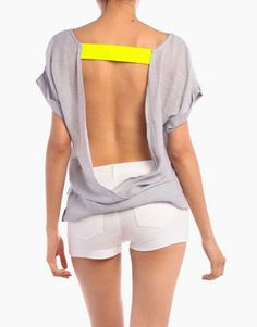 I feel like this top is DIY-able... find cheap plain loose tshirt target cut the back out, sew any band you want in between. done. sexy sexy! :)