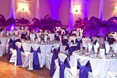 Purple uplights match the royal purple ribbons on these wedding tables #diyuplighting