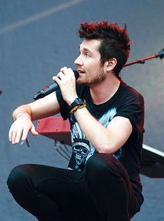 Dan Smith of Bastille, getting down, but not in a kinky way