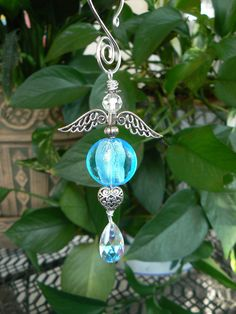 Turquoise colored puffed coin hand blown glass beaded hanging angel by LindaGillottiDesigns on Etsy