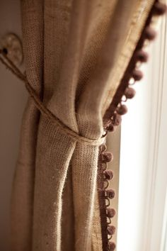 burlap curtain with fringe please. CHEAP and adorable. Pom pom fringe