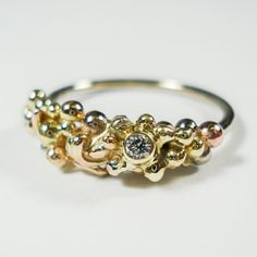 Elements ring with a diamond. Three tone gold. Www.hoogenboombogers.com