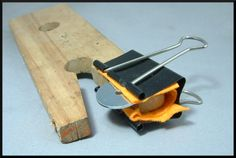 Good idea for holding small pieces to saw or file on your bench pin....