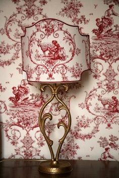 Toile wallpaper with matching lampshade