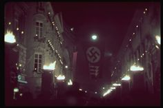 Hugo Jaeger—Time & Life Pictures/Getty Images Nighttime Munich is lit with torches and festooned with swastikas in celebration of the 15th anniversary of the 1923 Beer Hall Putsch, 1938.