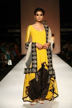 Payal Singhal Indian Wear Collection : : Noor Suit : Sunset Yellow Georgette And Woven Silk High Low Kurta Worn With Black Banarsi Silk Patiala Salwar And Ecru Tulle Dupatta With Black Silk Embroidered Border Indian Suits, Indian Attire, Indian Ethnic Wear, Indian Dresses, Punjabi Suits, Indian Style, Lakme Fashion Week, India Fashion, Ethnic Fashion