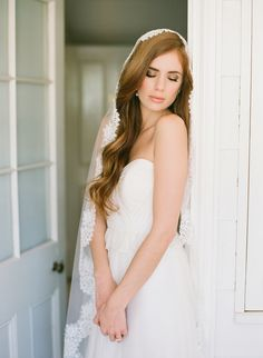 Romantic wedding hairstyle for long hair - it looks so beautiful with this mantilla veil! (photo by Jemma Keech)