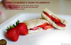 Yummy Strawberry & Cream Tea Sandwich!  Ingredients:  •	Whole-grain Sandwich Bread – 2 slices •	Whipped cream cheese – 2 tbsp  •	Honey – 1 tsp •	Strawberry – 4 sliced  Method: Toast the bread and top it with cream cheese, honey, and sliced strawberries. You can also top the bread slices with fruits of your choice.  #KLAYschools #recipe #yummy #children