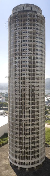 Oscar Niemeyer - Ghost Tower, Barra da Tijuca, Rio De Janeiro, Brazil, 60's.         Of the 70 120m high towers only four were actually constructed. Two are inhabited by wealthy citizens, one collapsed in the 90's and the fourth one was never finished. Two Dutch artists, Wouter Osterholt and Elke Uitentuis are currently trying (with the investors) to find 20 million dollar to finish the Ghost Tower after 40 years.