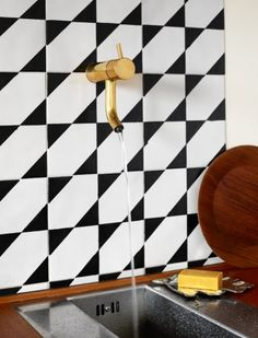 WE love all the different patterns made by the graphic backsplash tiles, and an unexpected gold faucet? Decor Inspiration, Kitchen Inspiration, Decor Ideas, Black And White Tiles, Black White, White Gold, Brass Faucet, Brass Tap, Faucets