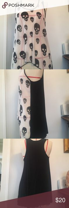 Skull white & black flowy & cotton tank top Super cute white and black long tank top with skull prints on white flowy front. Front is a bit see-through. Back of tank is black super soft cotton. Tank is basically new, wore it once, thought I was going to keep it but it was too big on me. Size M fits like a true M. If you're regularly a small and like things more form fitting this will be a little too baggy. Super cute with black/ white tank or with a fun Bralette under and paired with skinny…