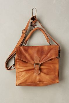 This is much too pricey but I love the style.  Long strap, flap and button closure.  Brown Leather.  More hippy than fancy or book bag. Osney Satchel  #anthropologie