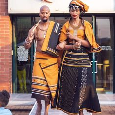 Couple In Beautiful Orange and Black Xhosa Umbhaco Traditional Attire - Clipkulture Couple In Beautiful Orange and Black Xhosa Umbhaco Traditional Attire
