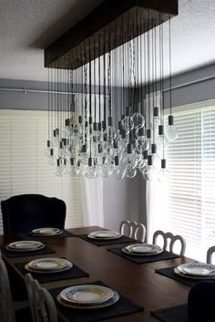 The light fixture becomes the focal point in this simple, understated dining room. Design Tip: install dimmer switches on all overhead lighting. Diy Light Fixtures, Dining Room Light Fixtures, Dining Room Lighting, Home Lighting, Overhead Lighting, Table Lighting, Diy Casa, Up House, Dining Room Inspiration