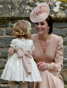 Catherine Duchess of Cambridge with her daughter Princess Charlotte at the wedding of Pippa Middleton and James Matthews. May 20 2017.