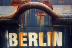 BERLIN - Lettering on a rusted skip