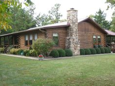 Definitely one of a kind, log home on 2-1/2 acres in Cherokee Village, AR.