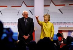 Democratic presidential candidates Sen. Bernie Sanders, I-Vt, and Hillary Rodham Clinton take the stage before a Democratic presidential primary debate at the University of Wisconsin-Milwaukee, Thursday, Feb. 11, 2016, in Milwaukee.