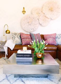 Love the use of the juju hats here and the pillows... I would probably change up the coffee table though...