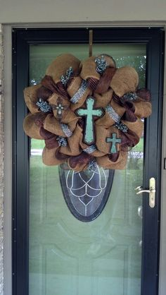 Large burlap and deco mesh wreath with three turquoise crosses
