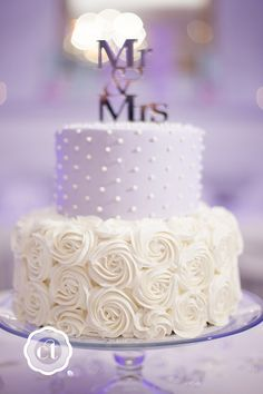 """purple rose wedding cake. We can help achieve this look by checking out our website for cake dummies, cake boards and cupcake stands! 10% off with """"pinterest2013"""" at www.dallas-foam.com"""