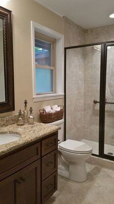 Traditional 3/4 Bathroom with Kensington Series Beige Porcelain Tile, High ceiling, Flat panel cabinets, Winstead Cabinets