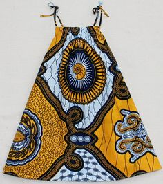 I can just see my future child wearing this african wax print dress with big afro puffs.