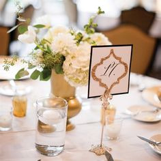 The table numbers were homemade and used a Moroccan-inspired motif and, you guessed it, more glitter.