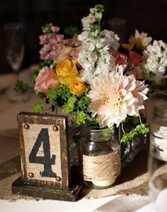 WeddingChannel Galleries: Rustic Centerpiece  Mismatch seasonal center pieces.