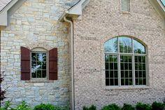 Custom Home, White Brick Exterior, Decorative Stone Apron / Window Trim, Shutters; Central Indiana