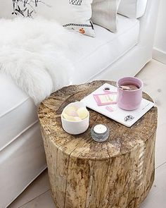 An old stump gives great texture to an all-white room.